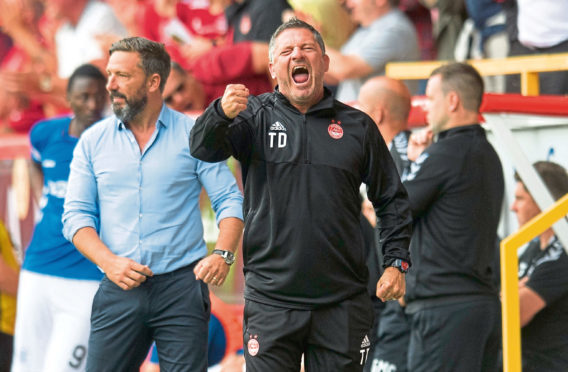 Aberdeen Assistant Manager Tony Docherty celebrates Bruce Anderson's late equaliser against Rangers earlier in the season.