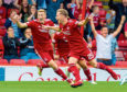 Aberdeen's Bruce Anderson wheels away after he scores the late equaliser against Rangers