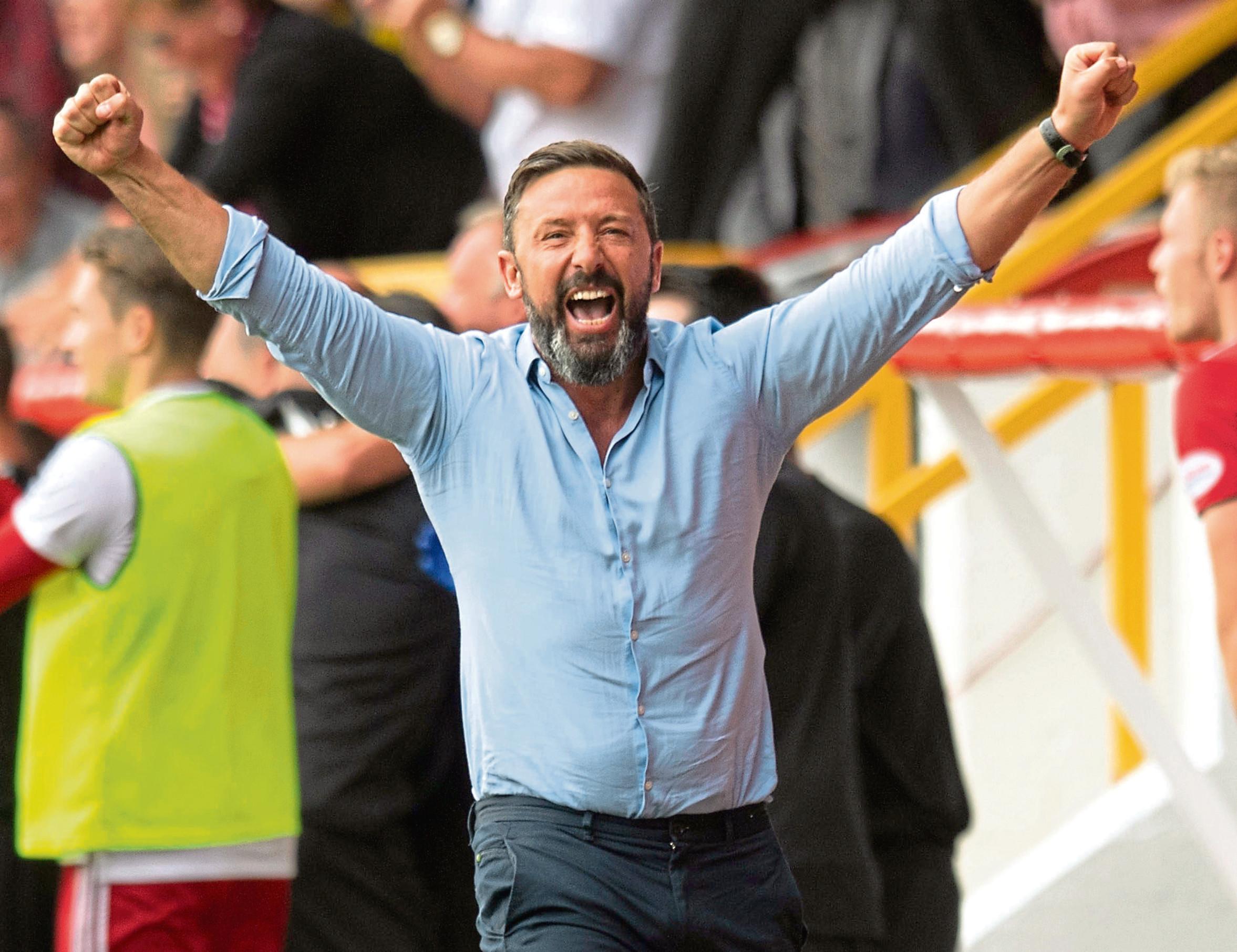Aberdeen Manager Derek McInnes celebrates Bruce Anderson's equaliser against Rangers.