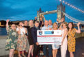 Dean Stott has handed over the cash to mental health charities