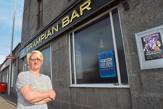 Kim Main, manager of the Grampian Bar, is not convinced the River Dee is to blame for the stench in Torry