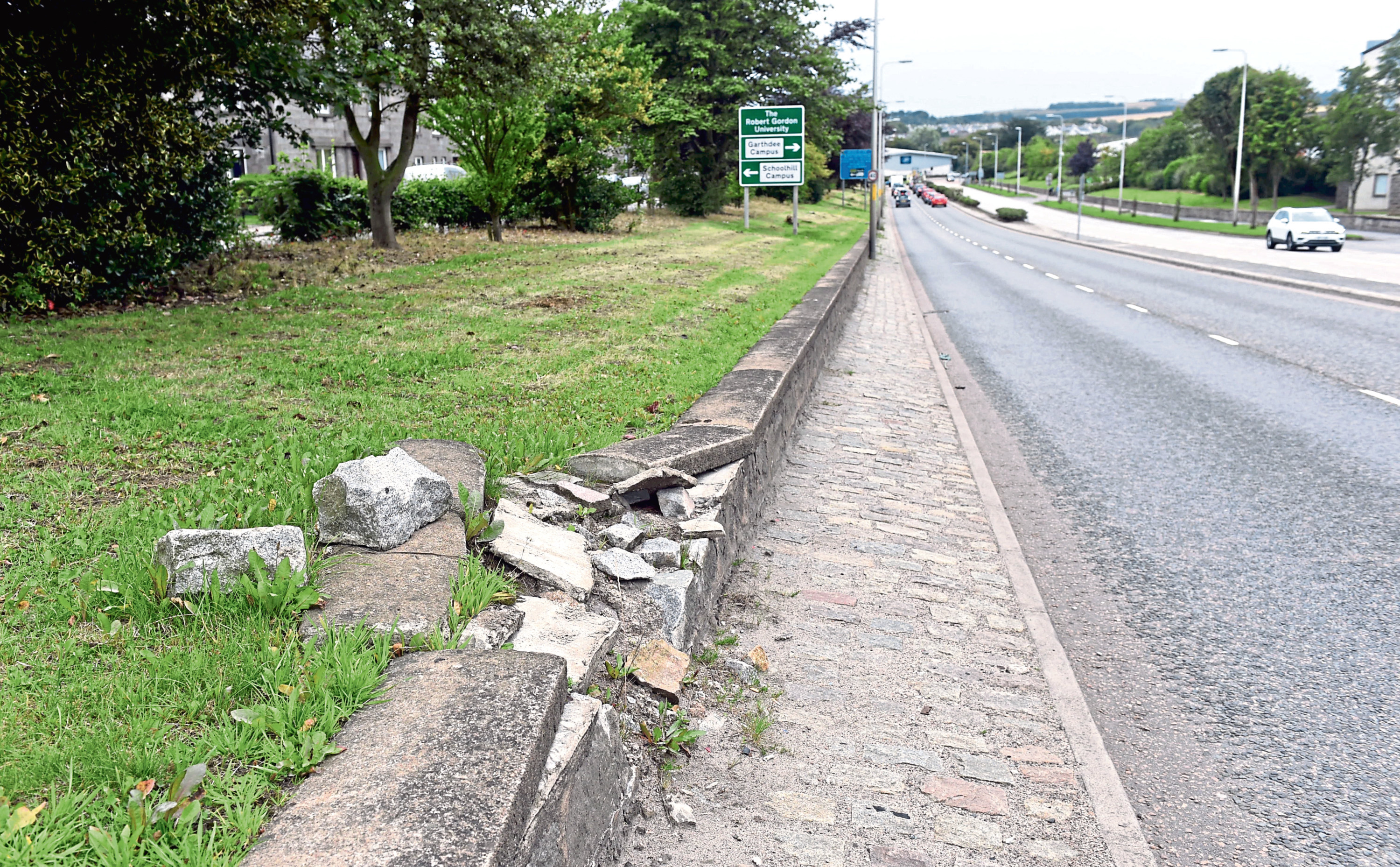 Cllr Yuill has called on action the damaged sections of the wall on the eastern side of South Anderson Drive on the southbound approach to Garthdee roundabout. He says they have been unrepaired for a number of years.  Pictured is the broken wall. 12/08/18 Picture by HEATHER FOWLIE