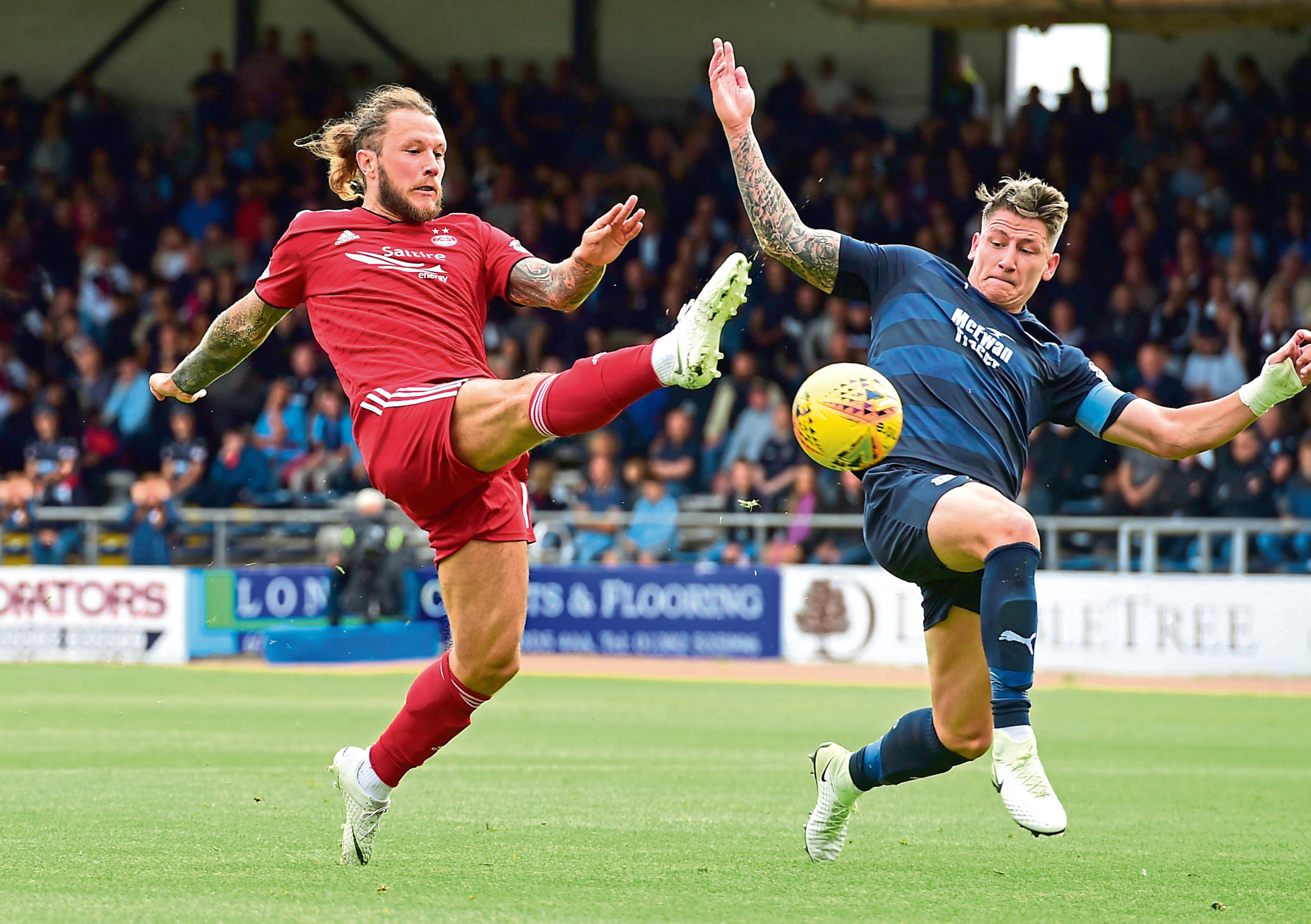 Aberden's Stevie May (left) and Josh Meetings in action.