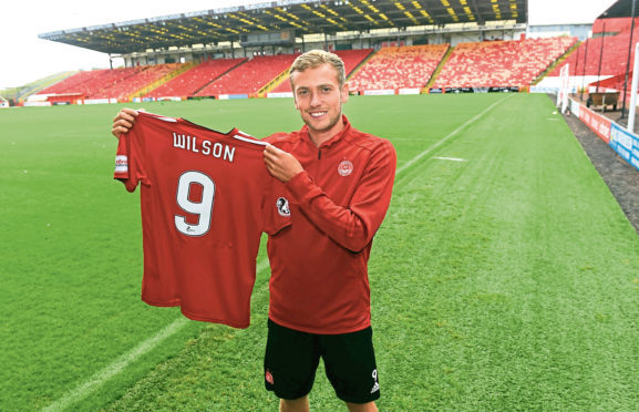 On loan Manchester United striker James Wilson  scored for Aberdeen against Livingston.