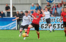 United's Conor Gethins and Locos' Connor Rennie Picture by Darrell Benns