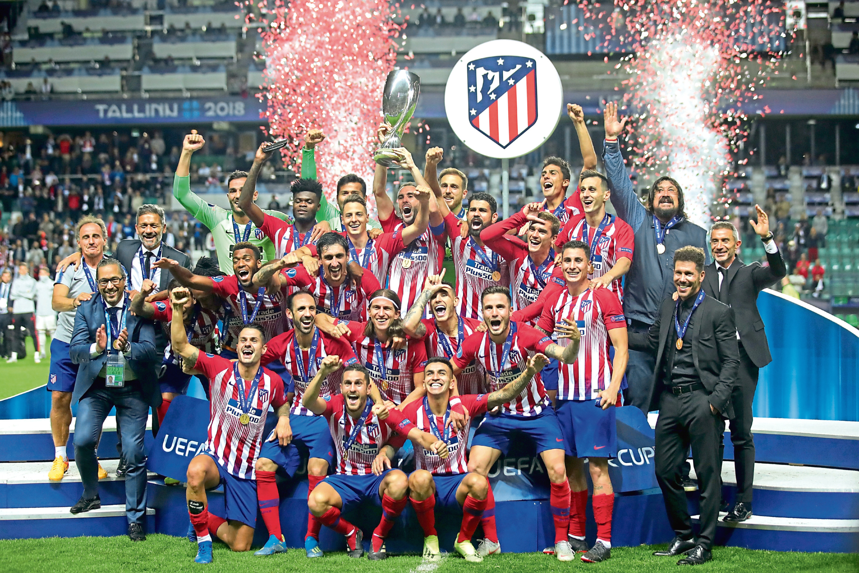 Atletico Madrid celebrate with the trophy following the UEFA Super Cup between Real Madrid and Atletico Madrid at Lillekula Stadium on August 15, 2018 in Tallinn, Estonia.