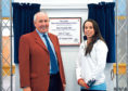 Beth Tweddle unveils the plaque with Colin G. Taylor.  Picture by Heather Fowlie
