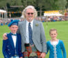 2006: Billy Connolly with young Highland dancers in Bellabeg Park, Strathdon