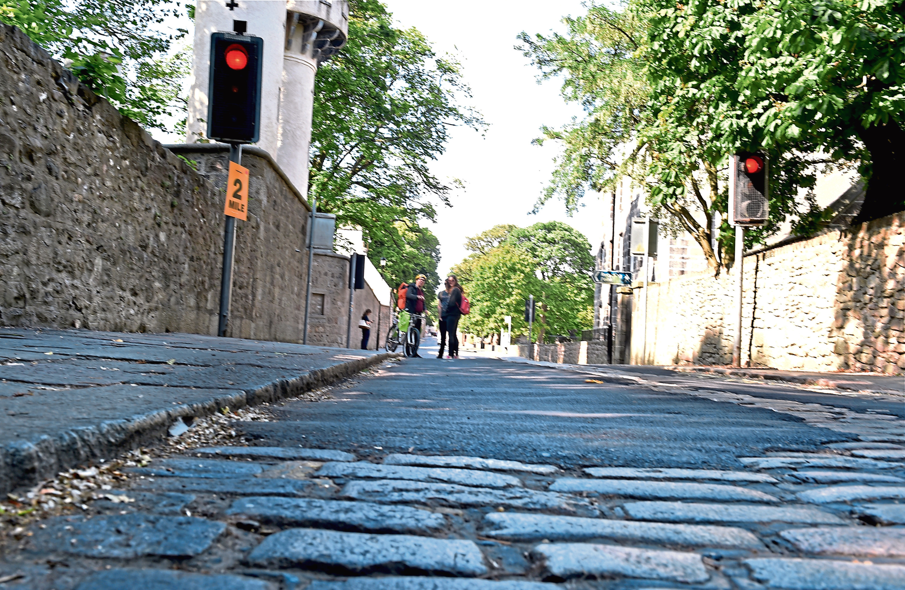 Old Aberdeen High Street where the cobbles were tarred over. Picture by COLIN RENNIE  July 13, 2018.