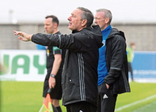 "McInally and Nicholls, behind, have been ""brilliant"" with McCarthy"