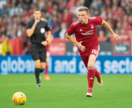 Lewis Ferguson in action for Aberdeen against Burnley in the Europa League.