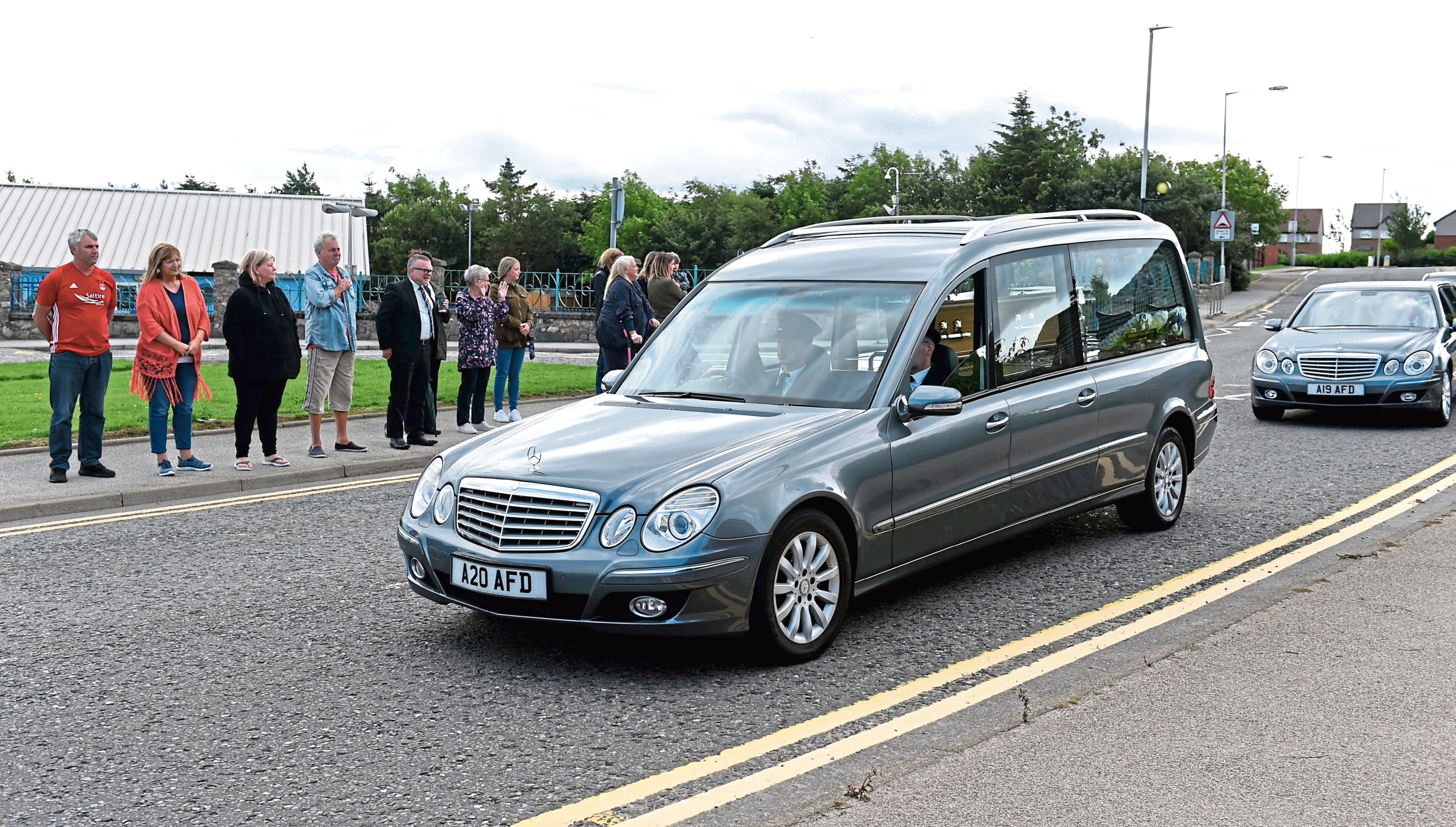 People gathered outside Charleston School for the hearse to pass.