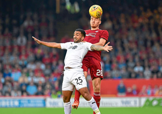 26/07/18 UEFA EUROPA LEAGUE SECOND QUALIFYING ROUND 1ST LEG  ABERDEEN V BURNLEY  PITTODRIE - ABERDEEN  Aberdeen's Tommie Hoban competes with Burnley's Aaron Lennon for a header