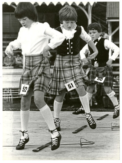 1987: Young Highland dancers try to impress the judges at the games