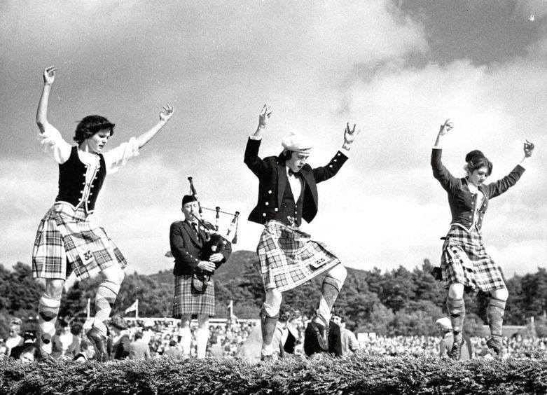 1977: Competitors show off their talents as they perform a Highland sword dance