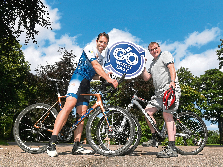 Cyclist Mark Beaumont left and Derek Muray from Nestrans