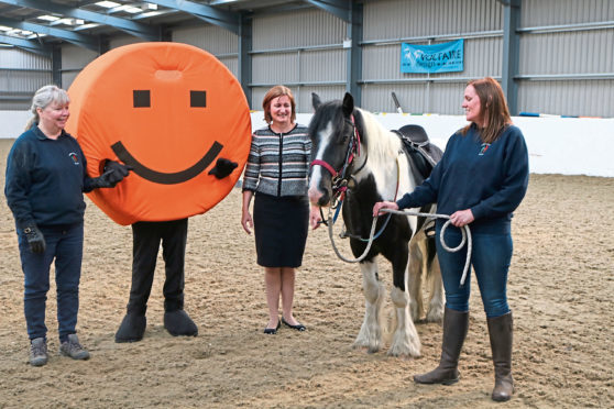 Muriel Simpson and Rhiannon Fraser, Trustees of Aberdeen RDA, with Teddy the pony and Karen Stewart of AABi