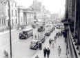 1958: Bikes, buses, cars and vans and even a horse and cart pass the Music Hall