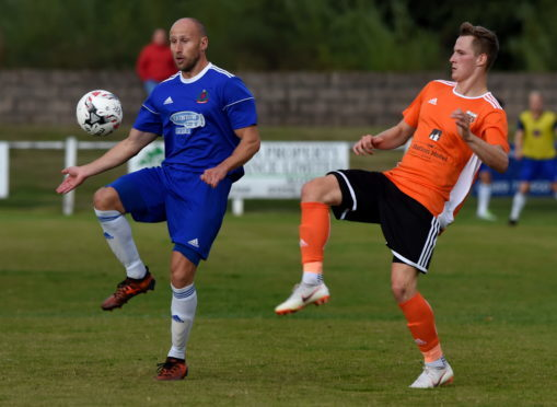 Alan Redford, left, in Highland League action.