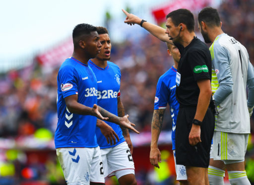 Alfredo Morelos is red carded for an off the ball incident with Scott McKenna.
