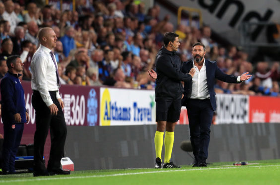 Aberdeen Manager Derek McInnes (right) as Burnley manager Sean Dyche looks on.