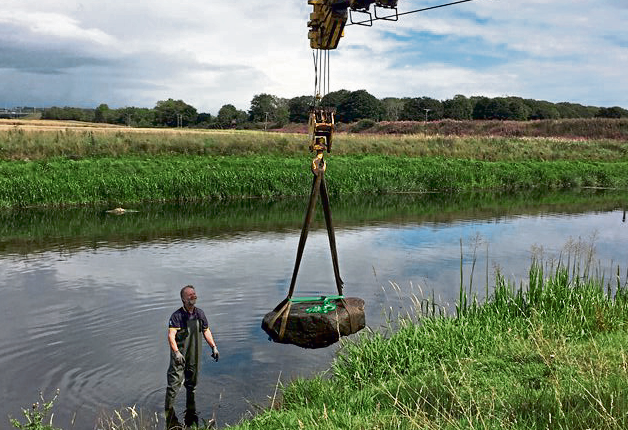 The stone was lifted out of the water using a crane