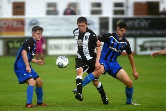 Pictured are Fraserburgh's Michael Rae and Huntly's Glenn Murison Picture by DARRELL BENNS.