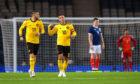 Belgium's Eden Hazard, right, celebrates as Scotland's players look frustrated.