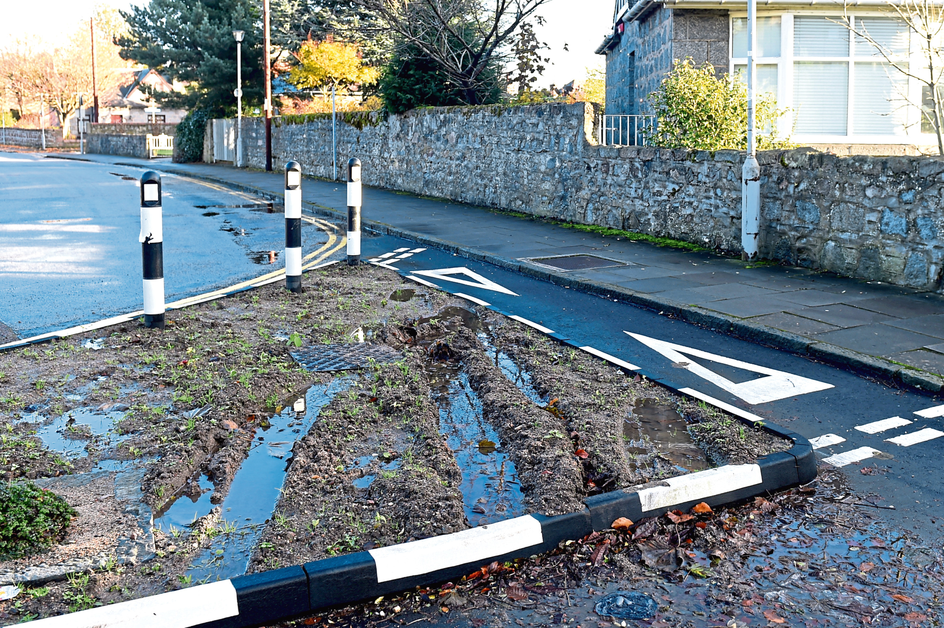 Residents around Don Street and Cheyne Road say drivers have been mounting the replacement island
