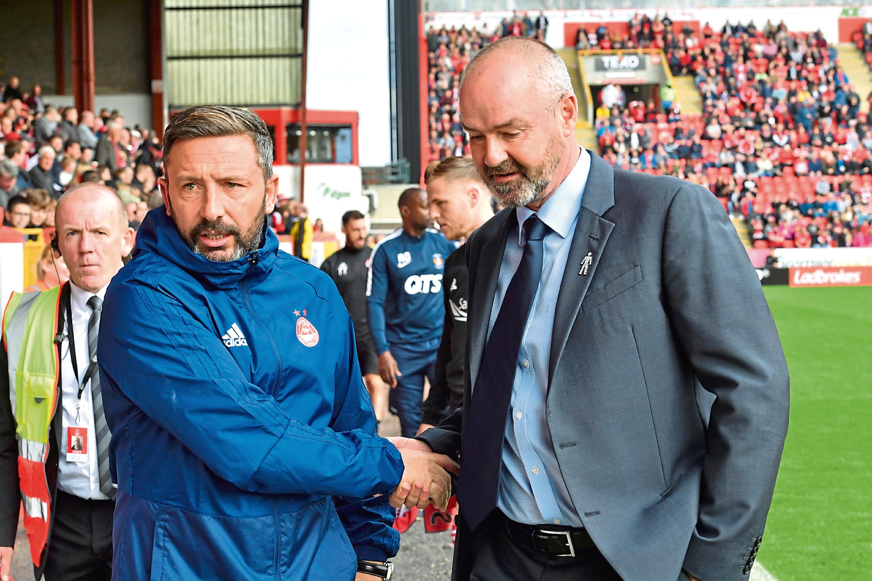 Aberdeen manager Derek McInnes, left, shakes hands with Kilmarnock manager Steve Clarke.