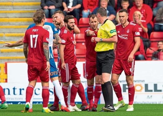 Aberdeen's Michael Devlin, left, is sent off by referee Craig Thomson.
