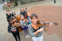 Nicola Benedetti with aspiring young musicians, from left, Dineo Makhatholela, Fergus Slater, Lucia-Elena Butnaru, Ella Skinner and Daniel Kondraciuk