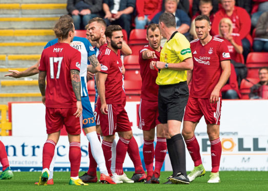 Aberdeen's Michael Devlin is sent off by referee Craig Thomson.