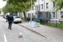 Police at the scene on Froghall Avenue, Aberdeen