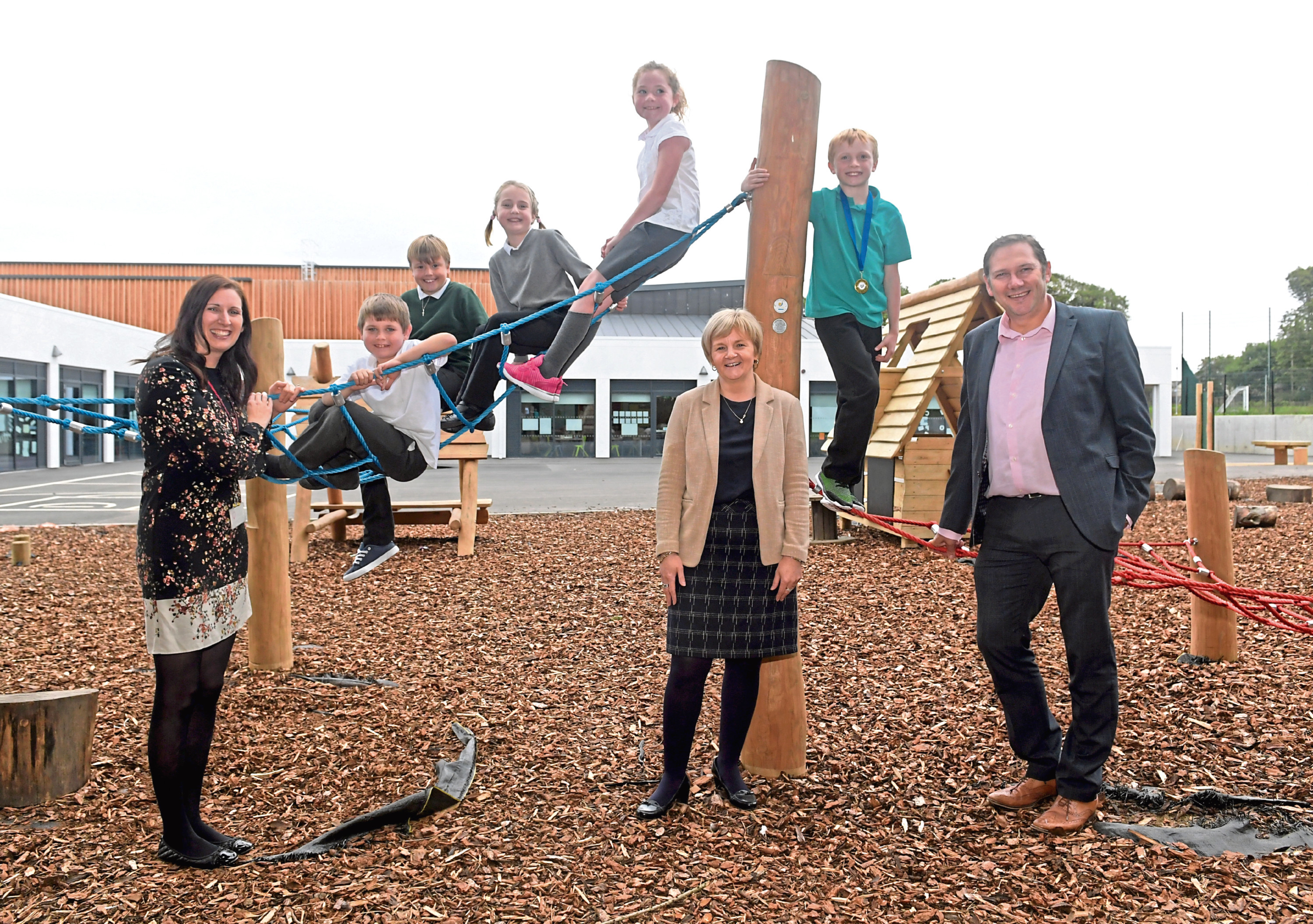 The new Stoneywood Primary School. From left, Headteacher Gael Ross with Council Co Leaders Jenny Laing and Douglas Lumsden and pupils, Carter Pearson, Samuel Paczoski, Mia Pritchard, Keira Duncan and Ben Morrice. 04/09/18. Picture by KATH FLANNERY