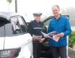 PC Lynne McEwan and Sandy Allan, RoSPA's road safety manager for Scotland