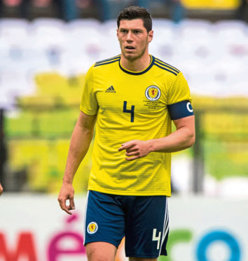 Scott McKenna in action for Scotland, as he captained the side in Mexico.