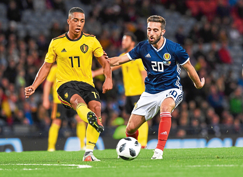 Scotland's Graeme Shinnie challenges Belgium's Yourie Tielemans