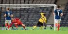 Belgium's Michy Batshuayi scores their third goal of the game.