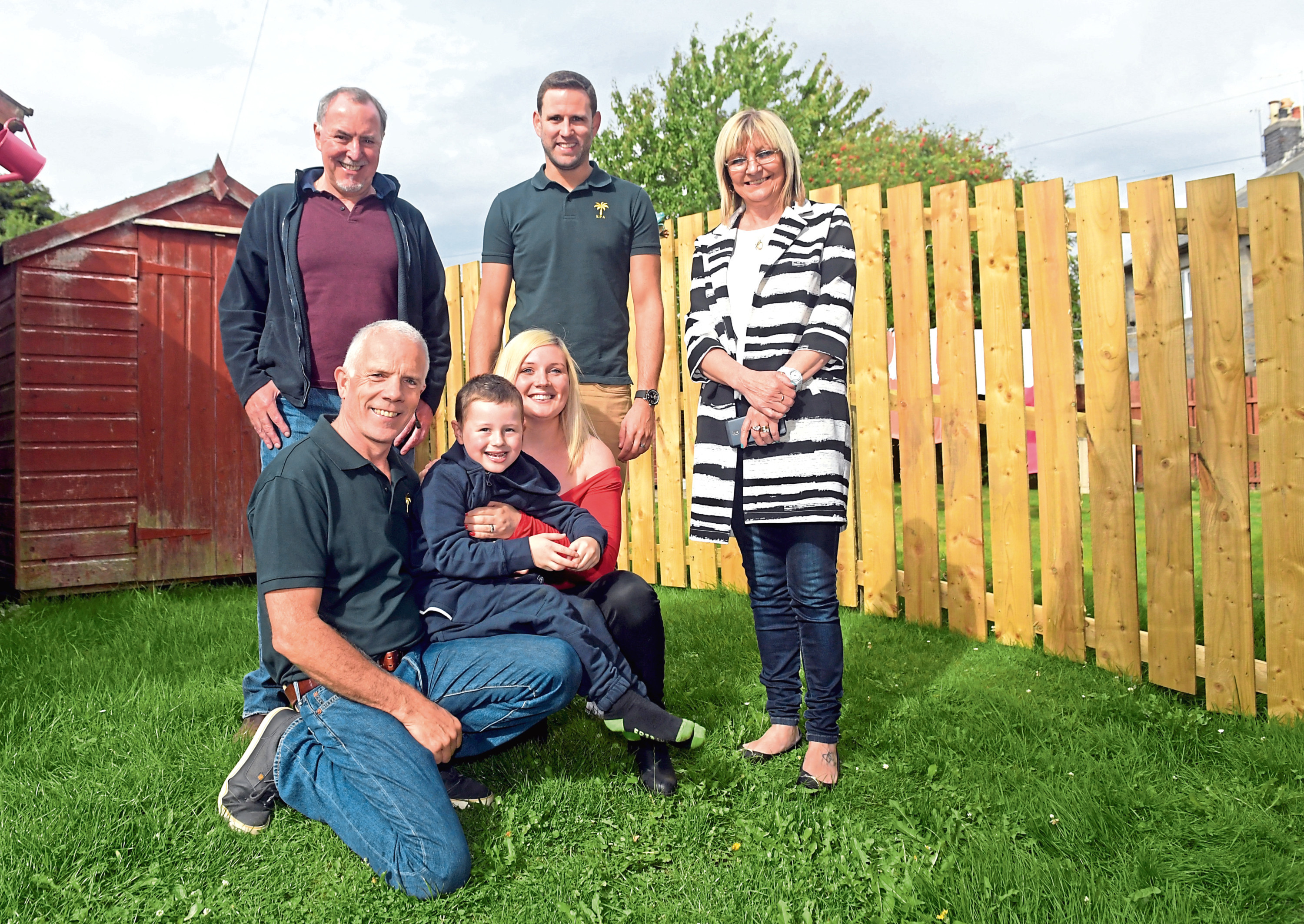 The Khyber Pass Association have completed a fence for Sarah Taylor's family in Kincorth