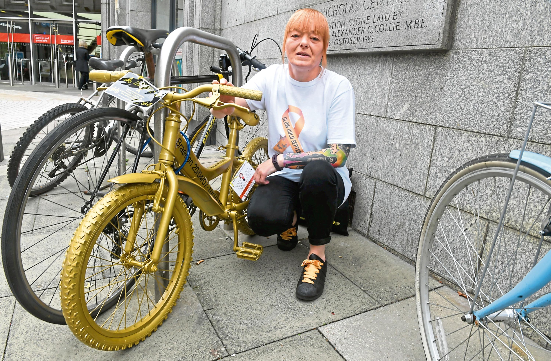 Milene Munro with a gold bike