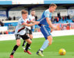 Peterhead's Rory McAllister in action against Bohemians.
