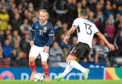 Scotland's Jonny Russell and Albania's Sabien Lilaj battle for the ball during the UEFA Nations League match at Hampden Park.