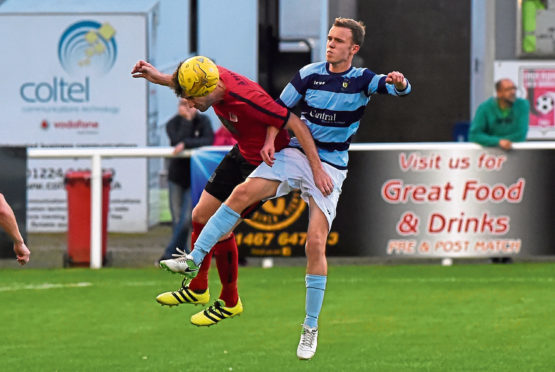Michael Phillipson duels with Inverurie Locos' Ryan Broadhurst in the first round.