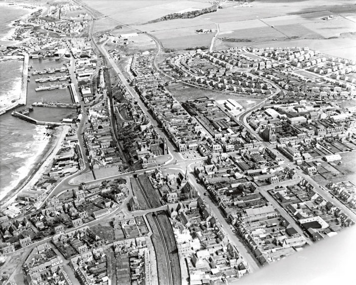 1971: An aerial view of the harbour and surrounding areas