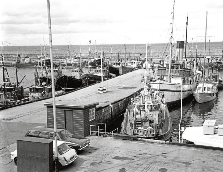1975: The harbour scene includes the German yacht Sharhorn