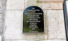 The plaque on Correction Wynd commemorating the first meeting