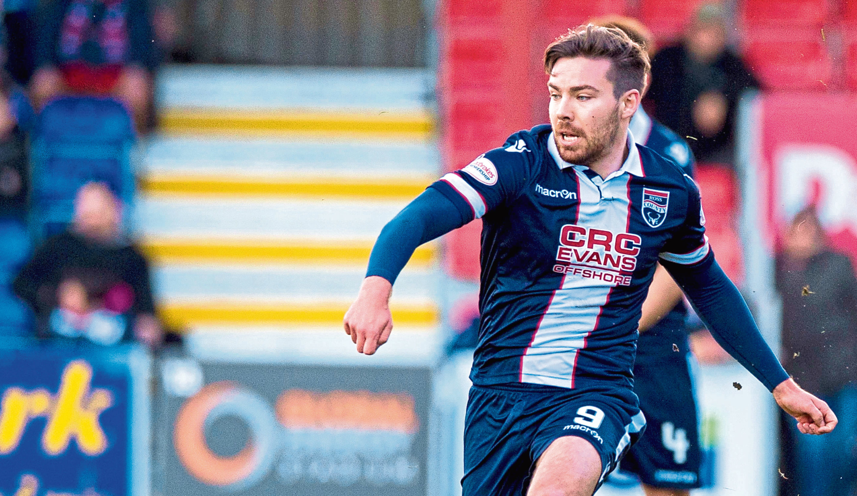 Ryan Dow in action for Ross County.