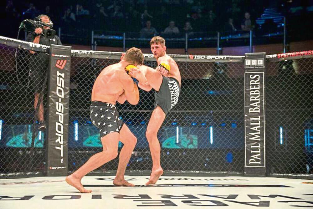 MMA fighter Paull McBain lands a kick on Steve Amiable at the O2.