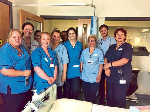 Staff at ARI, who said happy birthday to Margaret McRobbie in sign language